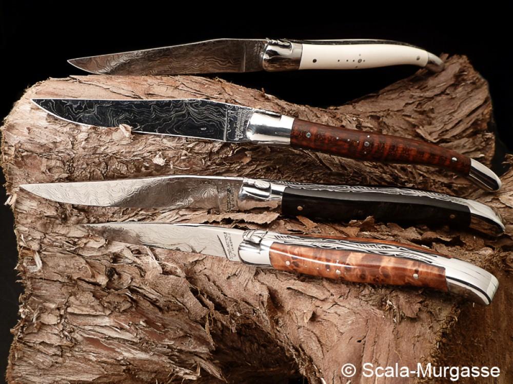 Messer Wien Laguiole Gentleman Taschenmesser der Firma Aubrac mit (v. unten) Thuja, Ebenholz, Amorette und Mammutelfenbeingriffschalen. Die Klingen bestehen aus rostfreiem Damast. laguiole en aubrac thuja amorette ebenholz mammutelfenbein damast taschenmesser gentleman knife rostfrei