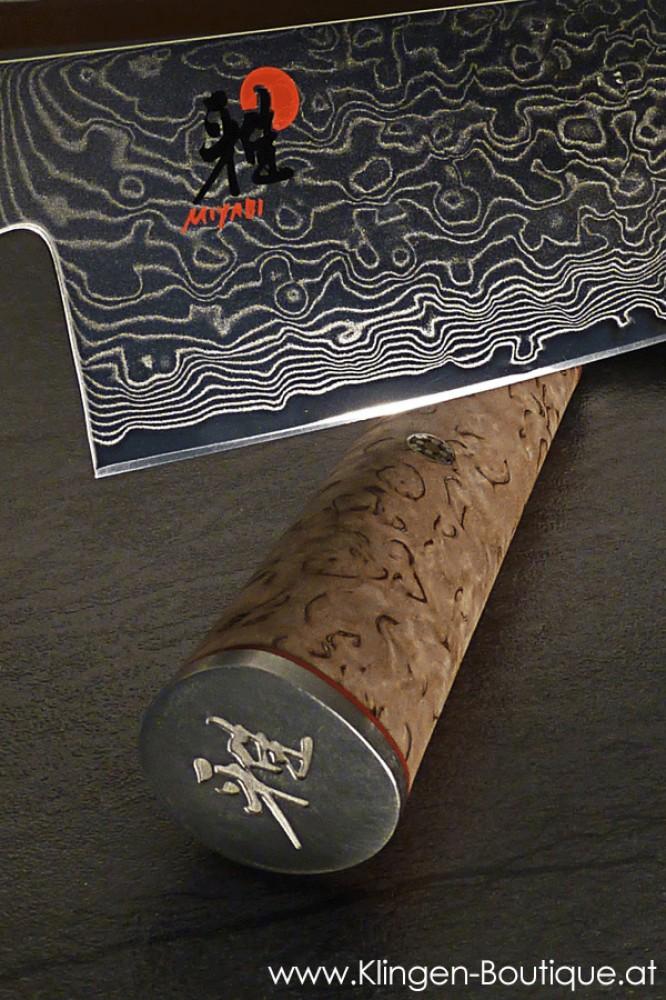 Messer Wien Japanische Kochmesser von Miyabi. Die Serie 5000MCD ist nicht nur extrem hart (63 HRC) und schnitthaltig, sondern auch äußerst elegant! Miyabi 5000 MCT mit 63 HRC Lagendamast. Messerblock aus Bambus, magnetisch. Griff aus Birkenholz. Lagendamast.